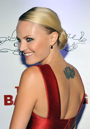 Malin showcased her lotus flower tattoo while walking the red carpet at the Toronto Film Festival.