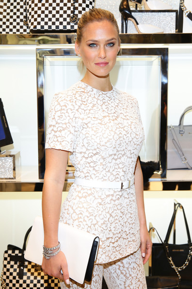 Bar Refaeli Leather Clutch [michael kors to celebrate milano - opening,bar refaeli,michael kors to celebrate milano,white,hair,clothing,fashion model,shoulder,fashion,dress,hairstyle,neck,haute couture,opening,milan,italy]