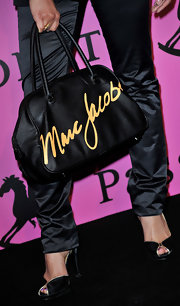 Severine Ferrer shoed off a darling nylon tote bag while attending this event. The designer bag was certainly something to gawk over.