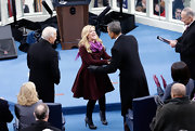 Kelly Clarkson sang at the inauguration celebration in this winter-chic maroon flared coat.