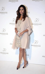 Camila Alves layered a nude shawl over a beaded dress for the Pronovias 50th anniversary fashion show.