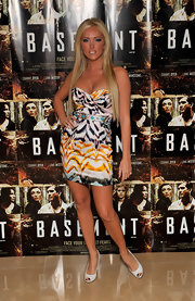 Aisleyne paired her peep toe pumps with a printed cocktail dress and long locks.