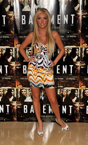 Aisleyne paired her printed dress with long flowing locks.