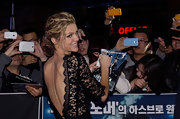 Brooklyn Decker attended the South Korean premiere of 'Battleship' wearing her hair in pinned-up curls with bright pink strands.