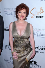 Caroline Manzo chose sparkly accessories for the Beach Bunny Swimwear fashion show--gold and silver bangles and a bejeweled clutch.