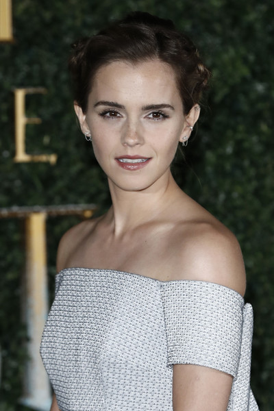 Emma Watson looked downright regal with her elegant braided updo at the 'Beauty and the Beast' UK launch event.
