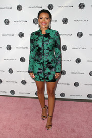 Kiersey Clemons highlighted her legs in a short green and black print dress by Eleanor Balfour at the Beautycon Festival LA 2018.