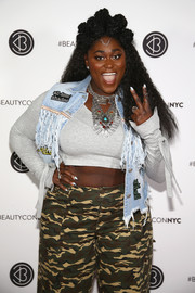 Danielle Brooks finished off her crop-top with a distressed denim vest.