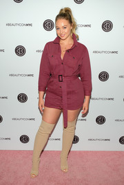 Iskra Lawrence donned a belted burgundy jacket dress for Beautycon Festival NYC 2018.