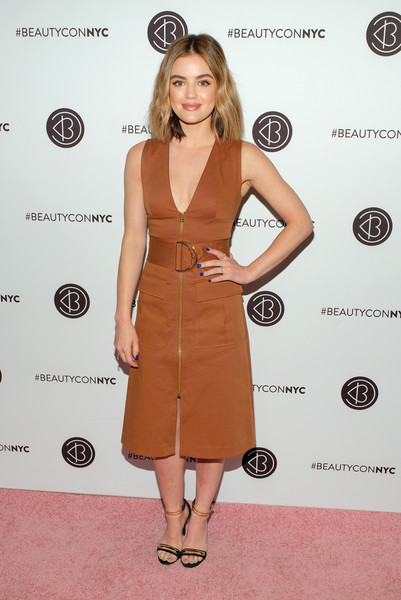 Lucy Hale was casual-chic in a brown zip-front midi dress by Diane von Furstenberg at Beautycon Festival NYC 2018.