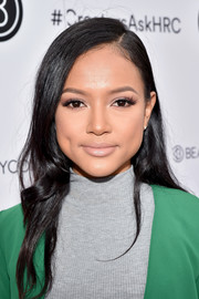 Karrueche Tran kept her beauty look understated with nude lipstick.