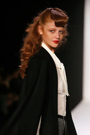Cintia Dicker had her tresses curled and tied half-up at the Fall 2012 presentation of Bebe's Black Collection.
