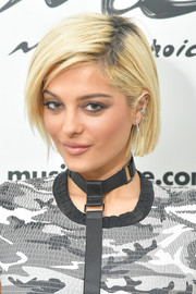 Bebe Rexha sported a blonde bob with dark roots while visiting Music Choice.