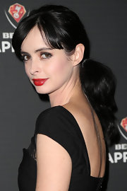 Krysten swept her raven waves into a low ponytail for Beck's Sapphire launch.