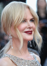 Nicole Kidman matched her embellished dress with a pair of diamond chandelier earrings.