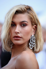 Hailey Baldwin gave her look a glamorous boost with a pair of statement crystal earrings.