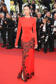 Liu Wen flashed her supermodel figure in a fitted red print gown at the Cannes Film Festival screening of 'The Beguiled.'