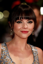 Christina Ricci attended the premiere of 'Bel Ami' wearing neutral shimmering shadow of shadow and loads of black mascara.