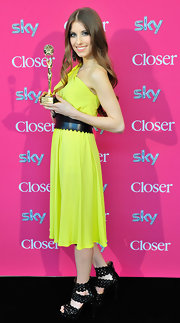 Cathy Fischer lit up the Beliebteste press reception with her bright yellow one-shoulder dress.