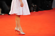 Isabelle Huppert's silver peep-toes were a glam finish to her ensemble at the 'Bella Addormentata' premiere.