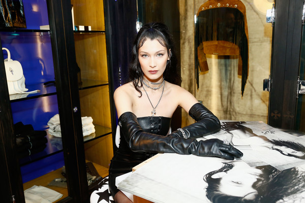 Bella Hadid Leather Gloves [lady,fashion,black hair,textile,leather,latex,gothic fashion,fetish model,bella hadid collaboration launch,bella hadid,part,paris,france,chrome hearts,chrome hearts x,store event,paris fashion week]