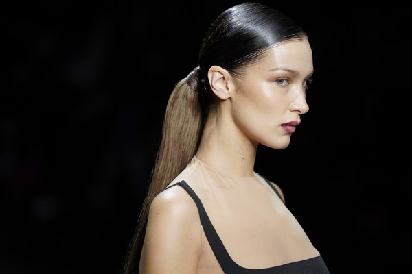 Bella Hadid Ponytail [hair,hairstyle,fashion model,beauty,fashion,eyebrow,chin,skin,shoulder,lip,bella hadid,part,runway,paris,france,paris fashion week womenswear fall,rochas,show,long hair,hair m,haute couture,fashion,supermodel,model,headpiece,brown hair,black hair,mannequin]