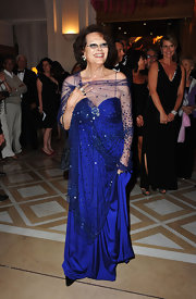 This royal blue evening gown with beaded shawl looked almost royal on Claudia Cardinale.
