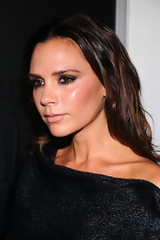 During Fashion's Night Out in NYC, Victoria Beckham paired a creamy nude lip with her smoky eyes. The lip color was full coverage, pale pink-beige with subtle shine.