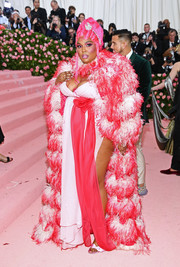 Lizzo topped off her flamboyant look with a feather cape, also by Marc Jacobs.