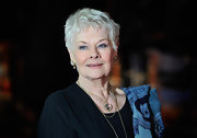 Judi Dench's crystal heart pendant lends a bit of sparkle to her all black outfit.