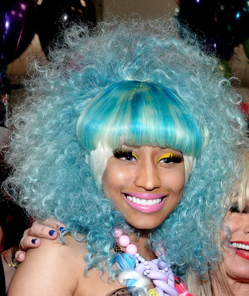Nicki Minaj's eyes were outstanding with vibrant lemon yellow shadow and super long false lashes at the Betsey Johnson spring 2012 fashion show.