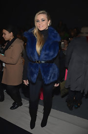 Carmen Electra wore an electrifying shade of blue with this royal blue fur vest.