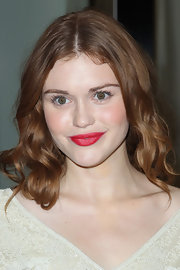 Holland Roden made a bold statement at Fashion's Night Out in Los Angeles. To recreate her super bright lipstick look, we recommend NARS Lipstick in Jungle Red. Apply, blot, apply and blot for maximum staying power.
