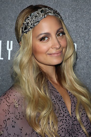 Nicole Richie embellished her luxurious locks with a bejeweled headband and kept her tresses in soft waves that cascaded over her shoulders. When wearing serious sparkle, a curling iron and a little workable hold hairspray like Bumble and Bumble Do Everything spray is all that's needed.
