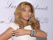 Beyonce Knowles knows how to promote a jewelry collection. The R & B star showed off a decadent diamond bracelet while attending the 2BHappy jewelry collection.