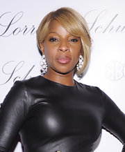 Mary J. Blige paired her sleek leather dress with an asymmetrical bob. The R & B diva opted for honey-blond undertones with subtle highlights.
