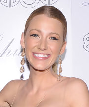 Blake Lively always looks stunning on the red carpet. The actress upgraded her look with tiered diamond drop earrings.