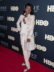Genevieve Jones kept her look monochromatic with  a white, top, skinny pants and trenchcoat.