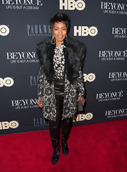 Angela Bassett opted for the black and white look with this black and white floral fur-trimmed coat.