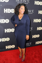 Oprah Winfrey played up her voluptuous figure in a shirred navy dress at the premiere of 'Beyonce: Life is But a Dream.'