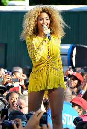 Beyonce Knowles hit the stage on 'Good Morning America' wearing a canary yellow crochet dress with a fringe skirt.