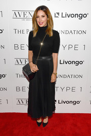 Ashley Tisdale opted for a simple and classic short-sleeve turtleneck when she attended the Beyond LA cocktail party.