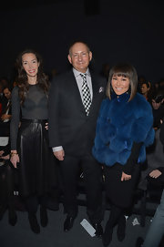 Alina Cho's bright blue fur coat added some whimsy to her all-black look at the Bibhu Mohapatra runway show.