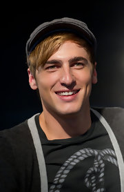 Kendall Schmidt's newsboy cap topped off his outfit in retro style.