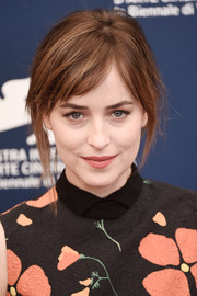 Dakota Johnson kept it casual with this loose updo at the Venice Film Fest photocall for 'A Bigger Splash.'
