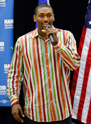 Metta World Peace burst with color in his striped button-down.