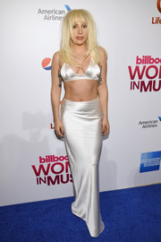 Lady Gaga went back to her signature skimpy style with this silver satin bra during Billboard's Women in Music event.
