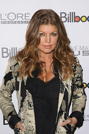 Fergie showed off her tousled curls while attending the Women in Music Awards.