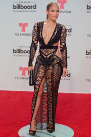 Jennifer Lopez attended the Billboard Latin Music Awards rocking this nearly naked Julien Macdonald number.