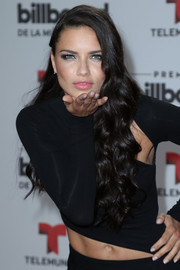 Adriana Lima wore her long hair loose with ultra-girly curls during the Billboard Latin Music Awards.